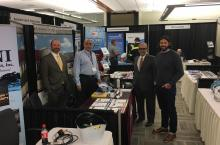 Accurate Environmental's exhibitor booth at the OWPCA Conference at Rose State College, October 2018. Pictured (left to right): Danny Chance, Stillwater Lab Manager; Ron Fazel, Lab Supplies Manager; Dr. Ali Fazel, President; Raun English, OKC Lab Manager.