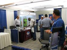 Accurate Environmental's exhibitor booth at OWPCA Conference at Rose State College